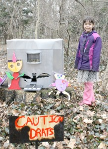 A student poses with her creation
