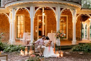 wedding couple on porch of Cope House