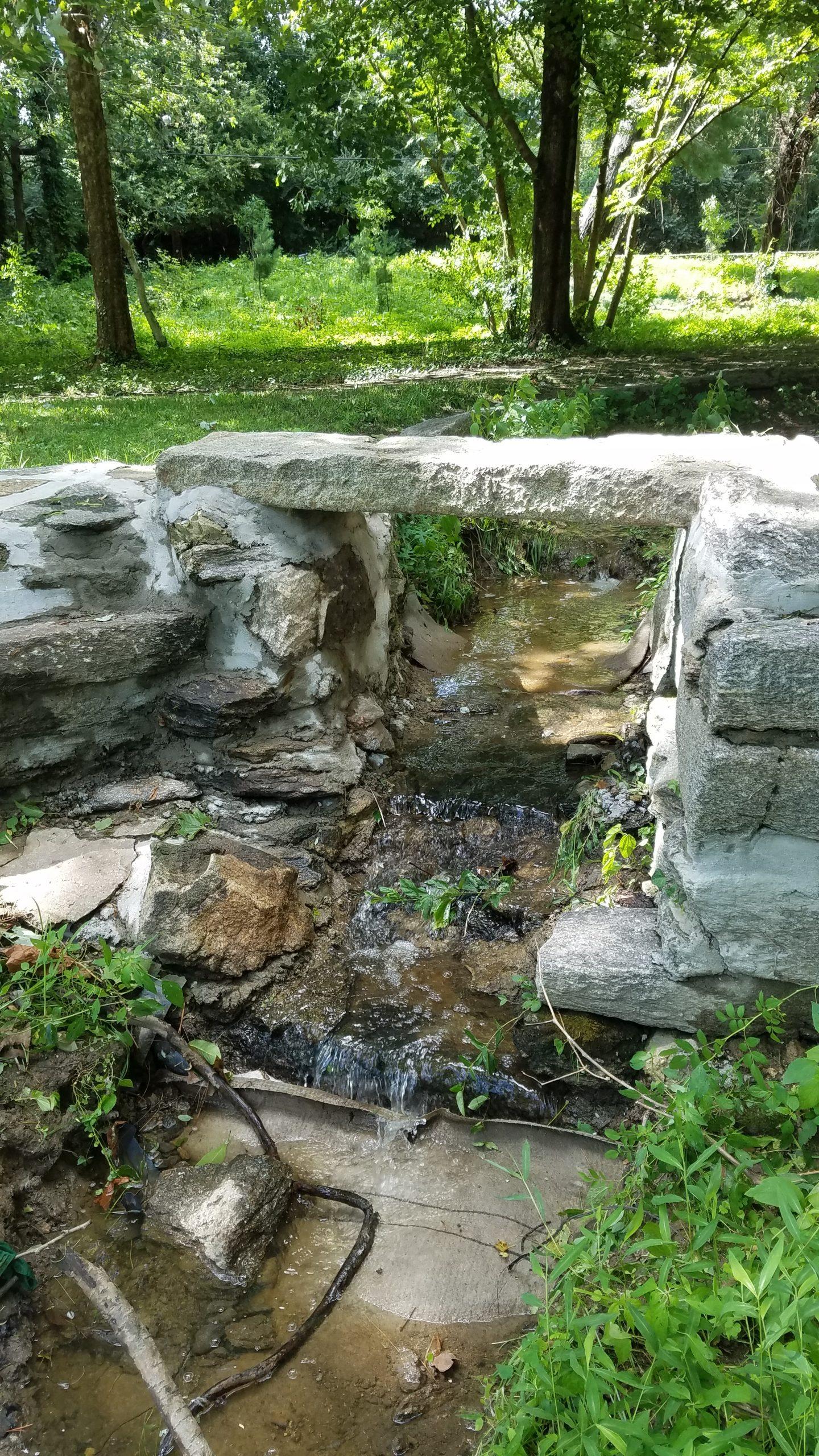 creek with stone footbridge